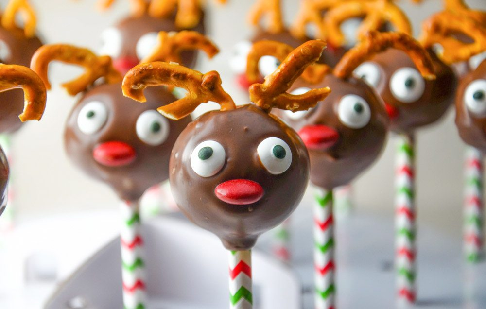 Fabulous Christmas Reindeer Pops. Delicious strawberry cake and white chocolate cream cheese frosting, specially decorated for the holidays.