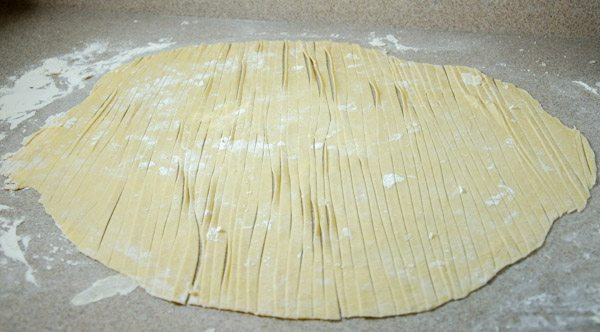 After 30 minutes, cut noodles. A pizza cutter works well. After cut, let sit for another 5 minutes.
