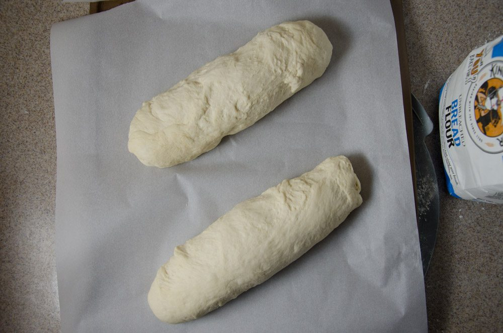 Form each half into a tight loaf. You need surface tension. (The loaf on the bottom is formed better.)