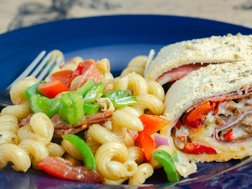 Stromboli and Italian Pasta Salad. Quick and easy. Favorite tangy Italian flavors- pasta, provolone, pepperoni, vegetables, and easy homemade vinaigrette.