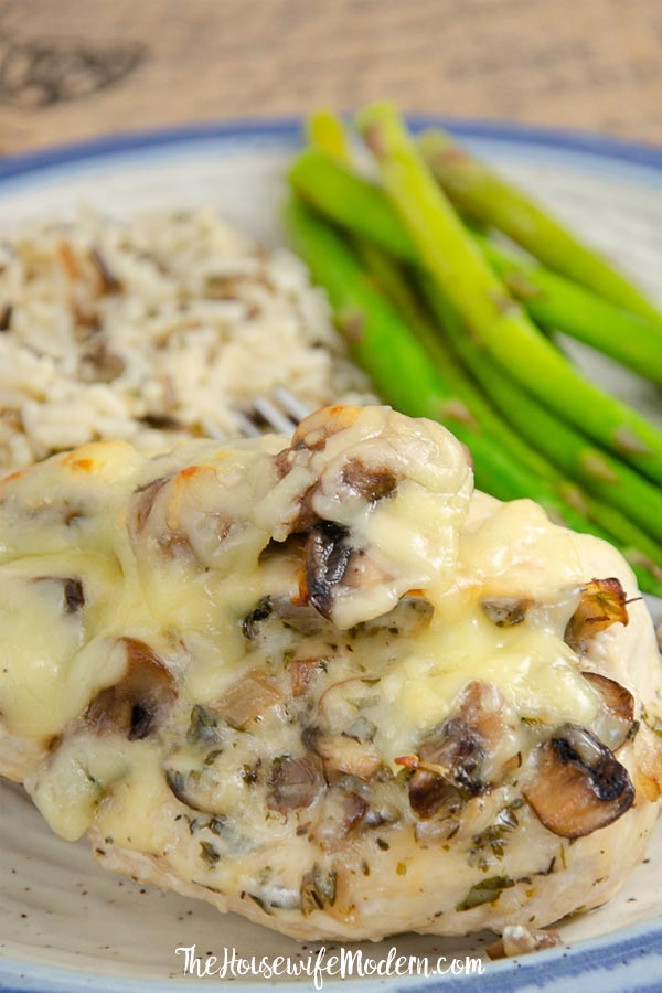 Pin image- Close-up of gouda and mushroom stuffed chicken.