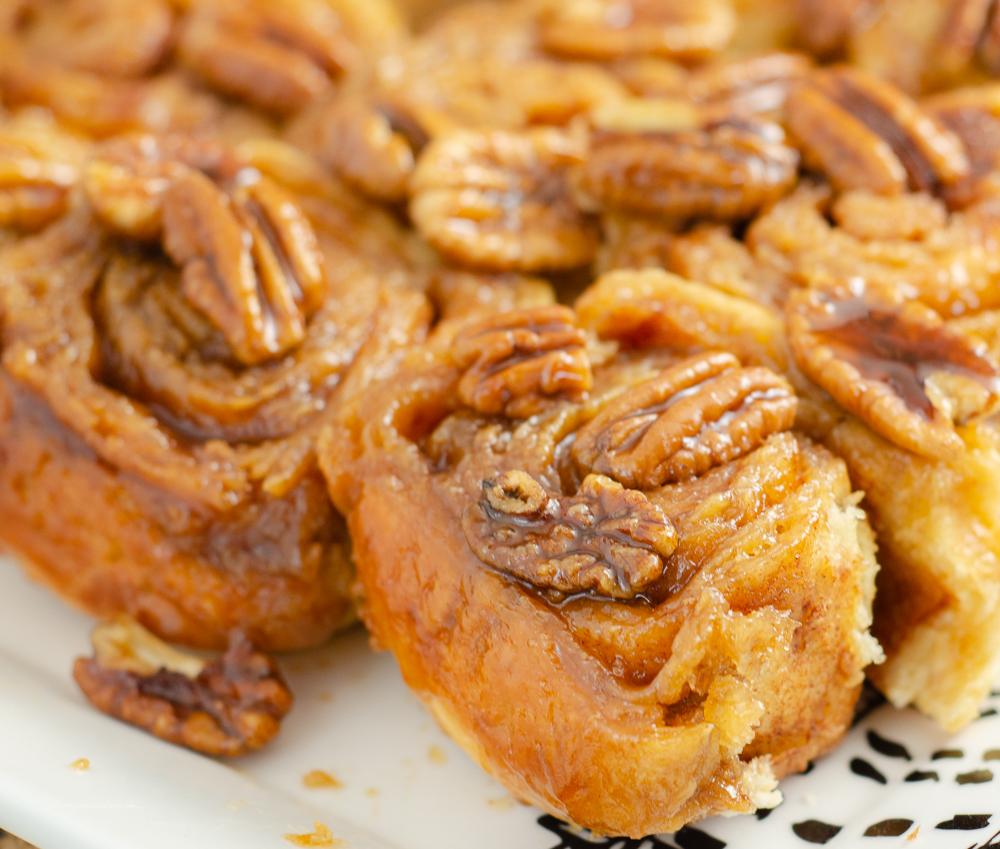 Close-up of caramel pecan cinnamon rolls.